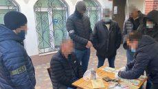 СБУ разоблачила канал сбыта поддельных долларов (фото)